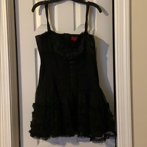Black tutu dress with corset design in the middle
